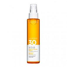CLARINS Солнцезащитное масло-спрей для тела и волос SPF 30.